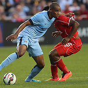 Fernando, (left), Manchester City, is challenged by Daniel Sturridge, Liverpool, during the Manchester City Vs Liverpool FC Guinness International Champions Cup match at Yankee Stadium, The Bronx, New York, USA. 30th July 2014. Photo Tim Clayton