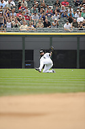 CHICAGO - JULY 27:  Carlos Quentin #20 of the Chicago White Sox makes a diving catch of a ball hit by Alex Avila #13 of the Detroit Tigers in the ninth inning on July 27, 2011 at U.S. Cellular Field in Chicago, Illinois.  The White Sox defeated the Tigers 2-1.  (Photo by Ron Vesely)  Subject: Carlos Quentin;Alex Avila