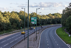 Licensed to London News Pictures. 27/09/2021. Dorking, UK. A very quiet rush hour on the A3 Kingston Bypass south-west London this evening (17:40), a major road in and out of the Capital and usually synonymous with long tailbacks as motorists continue to struggle to find petrol stations with fuel. Large queues have formed at petrol stations across the country over the weekend with many running out of fuel as oil giants struggle to maintain deliveries due to the lack of HGV drivers. Photo credit: Alex Lentati/LNP