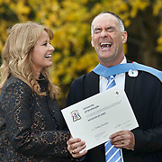Tommy Sheridan Scottish politician and co-convenor of Solidarity and now Bachelor of Laws LLB outside the Barony Hall in Glasgow after his University of Strathclyde graduation ceremony. With his wife Gail. Picture Robert Perry 11th Nov 2015<br /> <br /> Must credit photo to Robert Perry<br /> FEE PAYABLE FOR REPRO USE<br /> FEE PAYABLE FOR ALL INTERNET USE<br /> www.robertperry.co.uk<br /> NB -This image is not to be distributed without the prior consent of the copyright holder.<br /> in using this image you agree to abide by terms and conditions as stated in this caption.<br /> All monies payable to Robert Perry<br /> <br /> (PLEASE DO NOT REMOVE THIS CAPTION)<br /> This image is intended for Editorial use (e.g. news). Any commercial or promotional use requires additional clearance. <br /> Copyright 2014 All rights protected.<br /> first use only<br /> contact details<br /> Robert Perry     <br /> 07702 631 477<br /> robertperryphotos@gmail.com<br />        <br /> Robert Perry reserves the right to pursue unauthorised use of this image . If you violate my intellectual property you may be liable for  damages, loss of income, and profits you derive from the use of this image.