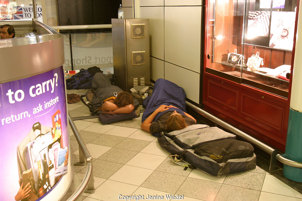 Passengers asleep on the floor at Gatwick airport due to delayed holiday flights.