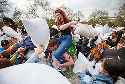 © Licensed to London News Pictures. 01/04/2017. London, UK. Revellers take part in a giant pillow fight in Kennington Park, London on International Pillow Fight Day on 1 April 2017. Photo credit: Tolga Akmen/LNP