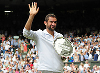 Tennis - 2017 Wimbledon Championships - Week Two, Sunday [Day Thirteen]<br /> <br /> Men Doubles Final match<br /> <br /> Marin Cilic (CRO) vs Rodger Federer (SUI)<br /> <br /> Marin Cilic with his runners up plate on  Centre court <br /> <br /> COLORSPORT/ANDREW COWIE