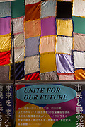 A microphone and a patchwork backdrop at the Unite For Our Future event. Shinjuku, Tokyo, Japan. Saturday October 23rd 2021. In an effort to unseat the ruling LDP (Liberal Democratic Party) in the October 31st Lower House election called by Japan's new Prime Minister, Fumio Kishida, the main, left-leaning opposition parties have decided to campaign together and not field candidates against each other.
