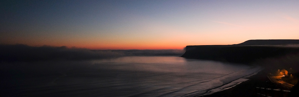 © Licensed to London News Pictures.02/11/15<br /> Saltburn, UK. <br /> <br /> A heavy fog bank rolls out to see from cliffs on the Cleveland coastline near Saltburn.<br /> <br /> Photo credit : Ian Forsyth/LNP