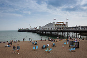 Brighton Pier and seafront on the 19th July 2018 in Brighton in the United Kingdom. The Brighton Palace Pier, commonly known as Brighton Pier or the Palace Pier is a Grade II* listed pleasure pier in Brighton, England, located in the city centre opposite the Old Steine.