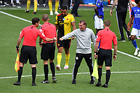 Football - 2019 / 2020 Premier League - Watford vs. Leicester City<br /> <br /> Leicester City manager Brendan Rodgers fist bumps with the officials after the 1-1 draw, at Vicarage Road.<br /> <br /> COLORSPORT/ASHLEY WESTERN
