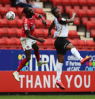 LONDON, ENGLAND - SEPTEMBER 25: Pape Souaré of Charlton Athletic and Mahlon Romeo of Portsmouth contest the header during the Sky Bet League One match between Charlton Athletic and Portsmouth at The Valley on September 25, 2021 in London, England. (Photo by Ben Peters/MB Media)