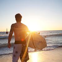Surfer looking at the pylon at Cottesloe Main Beach