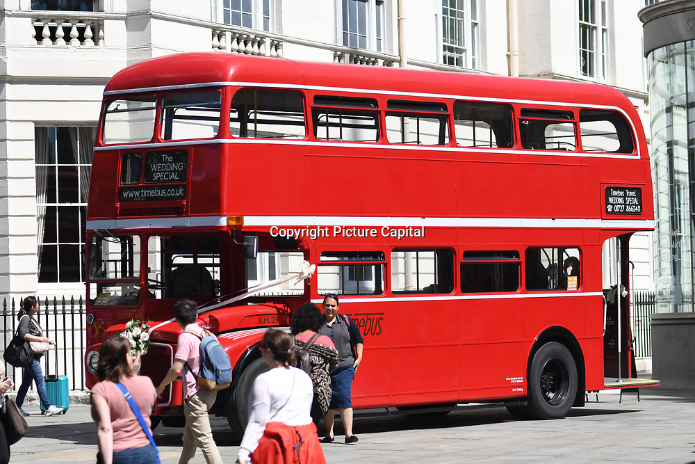 People takes picture of The Wedding Specail bus, display outside St Martin in the Field on July 28 2018, London, UK