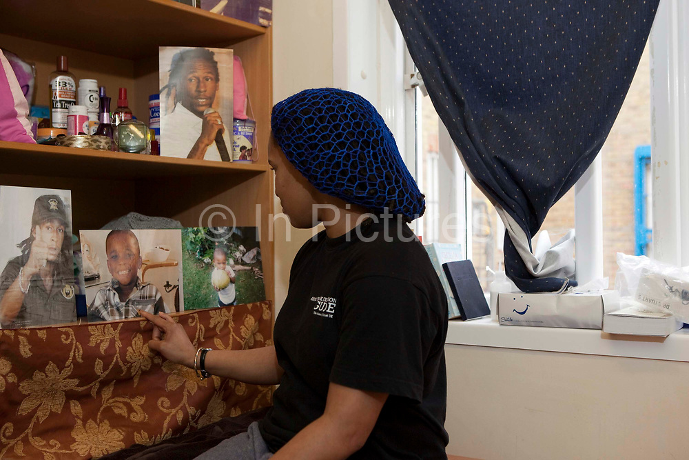 A prisoner looks at pictures of friends and family on display in her cell. HM Prison Send is a Closed Category women's prison, located in the village of Send (near Woking), in Surrey, England. The prison is operated by Her Majesty's Prison Service. Send is a closed prison for adult females. In addition it also houses a 20 bed Addictive Treatment Unit, an 80 bed Resettlement Unit and a 40 bed Therapeutic Community. HMP Sends Education Department runs Key Skills courses and NVQs in Business Administration. The Farms and Gardens department offers Floristry NVQs, and the Works Department run an industrial workshop and painting party. Prisoners held in the Resettlement Unit can also do voluntary work, attend College courses and Work Placements in the outside community.