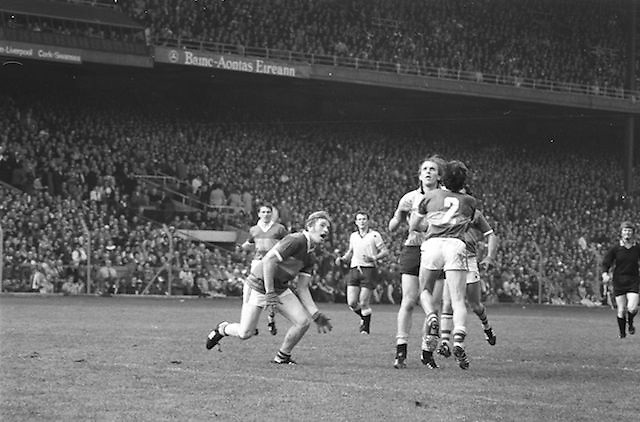 Dublin midfield player Brian Mullins trying to break through Kerry players to catch the ball during the All Ireland Senior Gaelic Football Final Dublin v Kerry in Croke Park on the 26th September 1976. Dublin 3-08 Kerry 0-10.