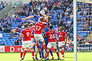Bristol City goalkeeper Daniel Bentley (1) punches the ball away from the head of Cardiff City forward Kieffer More (10) during the EFL Sky Bet Championship match between Cardiff City and Bristol City at the Cardiff City Stadium, Cardiff, Wales on 28 August 2021.