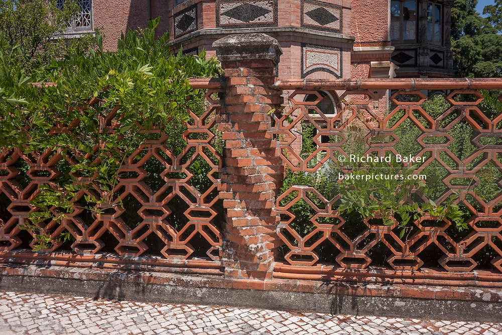 Ornate brickwork and faded grandeur in a mansion hotel at the spa resort of Luso, Portugal.