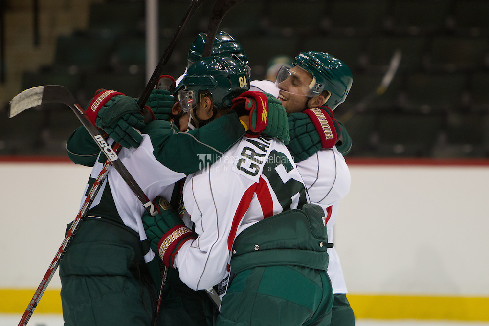 24 July 2012: Marco Scandella (6), Mikael Granlund (64), Matt Dumba (55) and Jason Zucker (16) have a friendly fight during the Minnesota Wild Development Camp at the Xcel Energy Center in St. Paul, Minnesota.