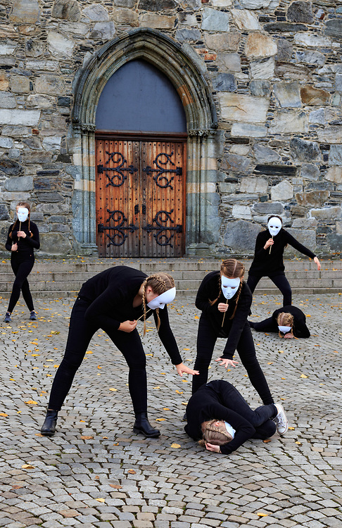 The performance in the front of Stavanger Cathedral, Norway. Stavanger Cathedral is Norway's oldest cathedral built around year 1225.