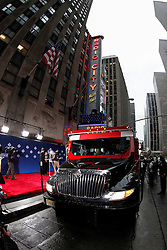 An armored truck arrives with New ERA hats before the first round of the NFL Draft on April 26th 2012 at Radio City Music Hall in New York, New York. (AP Photo/Brian Garfinkel)