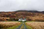 "A privately-owned self-catering farmhouse at Lochbuie, Isle of Mull, Scotland. Situated under cloud and a hillside behind we see the gravel track leading up to its fron tdoor around wich sheep graze on its land. Its remote location is ideal for those wanting solitude and peace in this beautiful corner of Mull. Lochbuie is a settlement on the island of Mull in Scotland about 22 kilometres (14 mi) west of Craignure. The name is from the Scottish Gaelic Locha Buidhe, meaning ""yellow loch"". http://lochbuie.com/Lochbuie"
