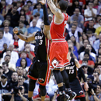 06 March 2011: Chicago Bulls point guard Derrick Rose (1) takes a jumpshot over Miami Heat shooting guard Dwyane Wade (3) during the Chicago Bulls 87-86 victory over the Miami Heat at the AmericanAirlines Arena, Miami, Florida, USA.