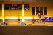 20 DECEMBER 2012 - SEGAMAT, MALAYSIA:  A woman walks through the train station in Segamat, Malaysia, on the line between Singapore and Kuala Lumpur.   PHOTO BY JACK KURTZ