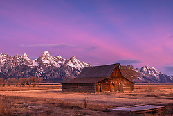 Jackson Hole Sunrise at the Moulton Barn.  The pioneers of the Rocky Mountains made the coolest looking barns not for aesthetics but because this is what they could drag out of the nearby woods. Thomas and John Moulton, the builders whether intentionally or accidentally faced this and John's barn the most advantageous angle for a perfect landscape composition.
