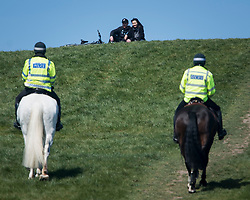 © Licensed to London News Pictures. 14/04/2020. London, UK. Mounted police patrol Primrose Hill in North London, during a pandemic outbreak of the Coronavirus COVID-19 disease. The public have been told they can only leave their homes when absolutely essential, in an attempt to fight the spread of coronavirus COVID-19 disease. Photo credit: Ben Cawthra/LNP