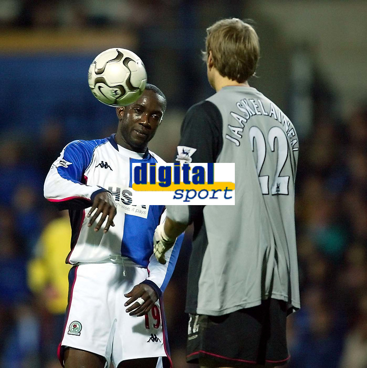 Photo. Aidan Ellis.<br /> Blackburn Rovers v Bolton Wanderers.<br /> FA Barclaycard Premiership.<br /> 10/01/2004.<br /> Blackburn's Dwight Yorke has a disagreement with Bolton's<br /> Jussi Jaaskelainen