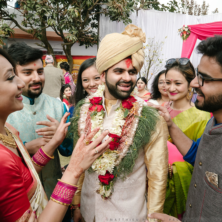The groom, who is from India, plays a traditional game with guest where he must bargain a price for the bride.