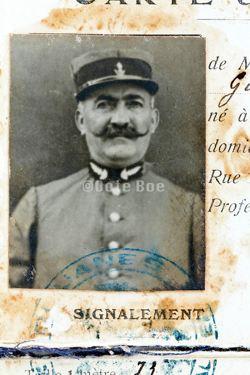 head shot photo on a French identity card 1920s