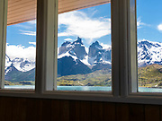 View of majestic Cuerno Principal and Torres del Paine National Park, Chile, from inside Hosteria Pehoe.