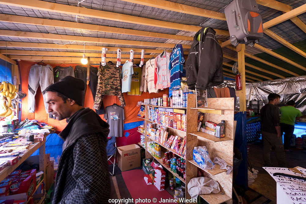 Interior of shops inside The Calais Jungle Refugee and Migrant Camp in France