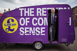 © Licensed to London News Pictures . 02/06/2014 . Newark , Nottinghamshire , UK . UKIP candidate ROGER HELMER on the UKIP caravan in Market Square , Newark , today (Monday 2nd June 2014), ahead of the by-election due to take place on Thursday (5th June 2014) . Photo credit : Joel Goodman/LNP