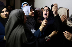 July 5, 2018 - Gaza City, Gaza Strip, Palestinian Territory - Relatives of Palestinian Mahmoud al-Ghrabli ,16, who died of wounds he sustained during clashes with Israeli troops, mourn during his funeral in Gaza city on July 5, 2018  (Credit Image: © Ashraf Amra/APA Images via ZUMA Wire)