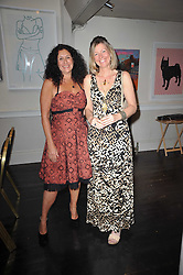 Left to right, JO MANUEL - founder of The Special Yoga Centre and ALISON BURGIN at The Special Yoga Centre's annual art auction held at the 20th Century Theatre, 291 Westbourne Grove, London W11 on 16th May 2011.