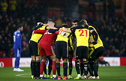 Watford players have a team huddle before the Premier League match at Vicarage Road, Watford.