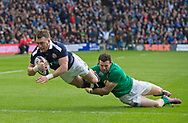 Six Nations 2017<br /> Scotland v Ireland, Murrayfield Stadium, Edinburgh.<br /> <br /> Stuart Hogg scores his 1st try with Robbie Henshaw on tow<br /> <br /> <br /> <br />  Neil Hanna Photography<br /> www.neilhannaphotography.co.uk<br /> 07702 246823