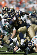 St Louis Rams running back Marshall Faulk runs off tackle during the Miami Dolphins 31-14 victory over the  Rams on October 24, 2004 at Pro Player Stadium in Miami, Florida.