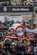The crowd in Trafalgar Square - #March4Women 2018, a march and rally in London to celebrate International Women's Day and 100 years since the first women in the UK gained the right to vote.  Organised by Care International the march stated at Old Palace Yard and ended in a rally in Trafalgar Square.
