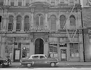 9903-503-09.  SW Oak St., south side of block between 2nd & 3rd. Frank T. Berry Bail Bonds, Joe Levy Bail Bonds. Vertical. August 1954.