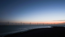 © Licensed to London News Pictures. <br /> 16/01/2015. <br /> <br /> South Gare, United Kingdom<br /> <br /> The offshore wind farm at South Gare near Redcar in Cleveland has the turbines working at first light after strong overnight winds.<br /> <br /> Photo credit : Ian Forsyth/LNP