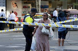 BARCELONA (SPAIN), Aug. 17, 2017  A police officer asks a woman to leave Plaza Catalonia following a terrorist attack in central Barcelona, Spain, on Aug. 17, 2017. Thirteen people were killed, 80 others injured and hospitalized with 15 of them in serious condition in Barcelona terrorist attack on Thursday afternoon, Spanish official said. (Credit Image: © Lino De Vallier/Xinhua via ZUMA Wire)