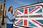 Helen Whately MP at the National Farmers Union NFU took machinery, produce, farmers and staff to Westminster to encourage Members of Parliament to back British farming, post Brexit on 14th September 2016 in London, United Kingdom. MPs were encouraged to sign the NFU's pledge and wear a British wheat and wool pin badge to show their support.