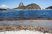 Rubbish litter pollution on Botafogo beach near the marina, Rio de Janeiro, Brazil.