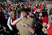 A woman hugs her new marine son after graduation.  Marine Corps Recruit Depot at Parris Island in South Carolina is where all male recruits living east of the Mississippi River and all female recruits from all over the US receive their arduous twelve week training in their quest to become marines. Even though there are two current active wars and a weak economy, recruitment has not been effected.  Actually, recruiting numbers have increased, with more young men and women looking toward the military for answers.