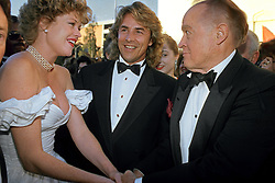Melanie Griffith, nominated for Best Actress in a Leading Role for the film 'Working Girl' with Don Johnson and Bob Hope on the red carpet