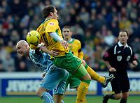 Photo: Daniel Hambury.<br />Coventry City v Norwich City. Coca Cola Championship.<br />26/11/2005.<br />Norwich's Dean Ashton (R) battles with Coventry's Robert Page.