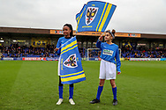 AFC Wimbledon fans waving flas during the EFL Sky Bet League 1 match between AFC Wimbledon and Accrington Stanley at the Cherry Red Records Stadium, Kingston, England on 6 April 2019.