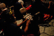 Traditional Balinese Gamelan orchestra, performing outdoors at night. Sanur, Bali, Indonesia.