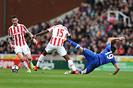 Diego Costa of Chelsea ® clashes with Bruno Martins Indi of Stoke city ©. Premier league match, Stoke City v Chelsea at the Bet365 Stadium in Stoke on Trent, Staffs on Saturday 18th March 2017.<br /> pic by Andrew Orchard, Andrew Orchard sports photography.