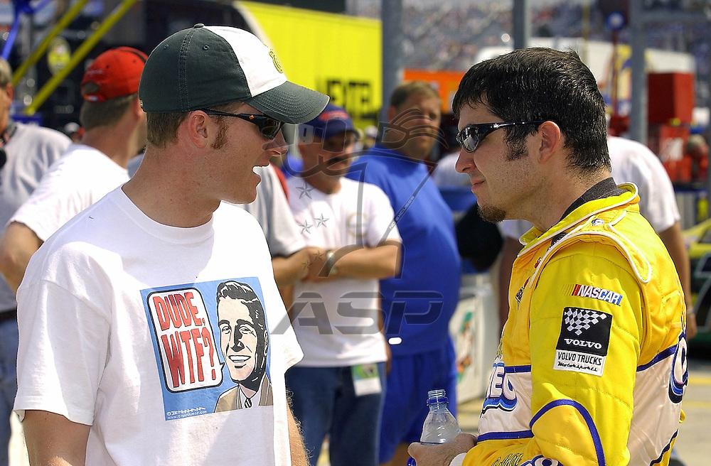 Dale Jr talks after the Carquest Auto Parts 300 to his driver Martin Truex Jr.
